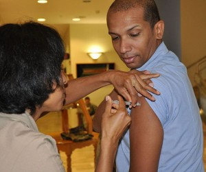 A vaccination that includes thimerosal.